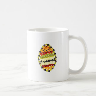Egg shaped fruit pie with various fruits coffee mug