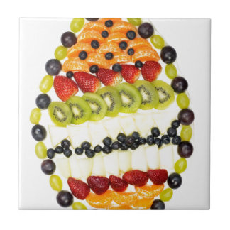 Egg shaped fruit pie with various fruits tile