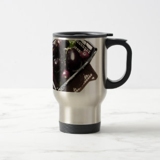 Eggplants in box on white background travel mug