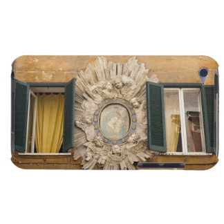 elaborate shrine squeezed between shuttered iPod touch Case-Mate case