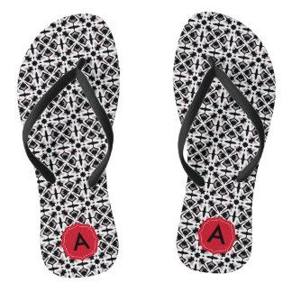 Elegant black and white pattern with red monogram thongs