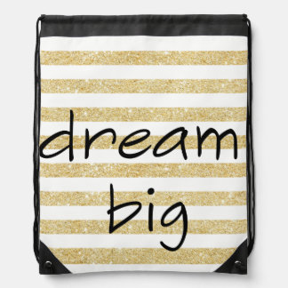elegant dream big text on a gold and white drawstring bag