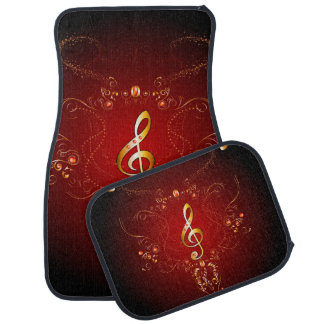 Elegant golden clef with floral elements car mat