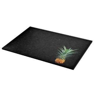 elegant minimalist pineapple   black background cutting board