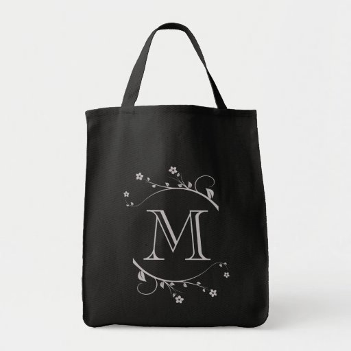 Elegant monograma and branches in flower in bag