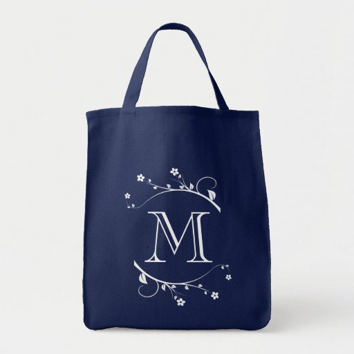 Elegant monograma and white flowers in bag