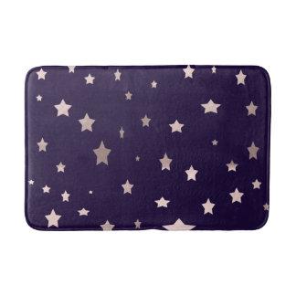 elegant rose gold stars on a purple background bath mat