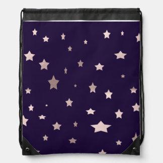 elegant rose gold stars on a purple background drawstring bag
