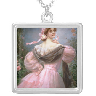 Elegant woman in a rose garden silver plated necklace