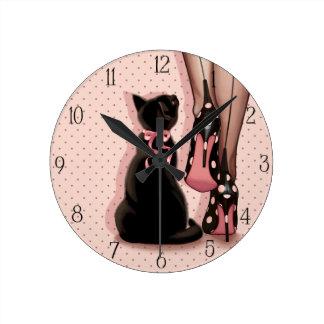 Elegant young woman and black cat clock