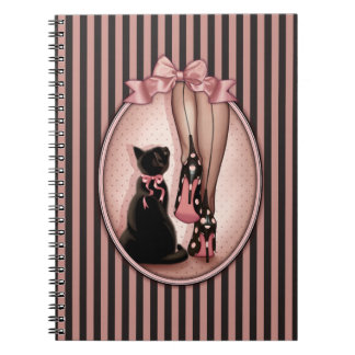 Elegant young woman and black cat notebooks