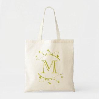 Elegante monograma lima y flores de primavera bolsas