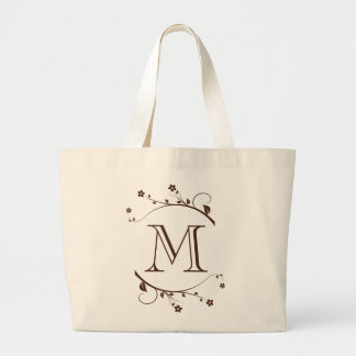 Elegante monograma marrón y flores en bolsas de mano