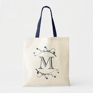 Elegante monograma y flores azul marino bolsa