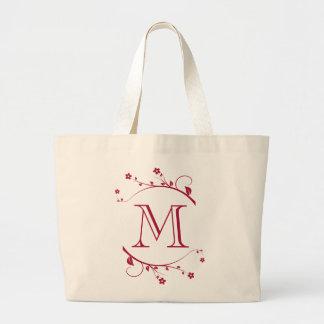Elegante monograma y flores burdeos en bolsas lienzo
