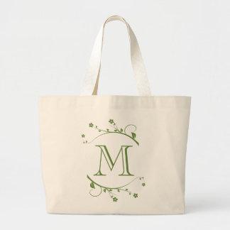 Elegante monograma y flores verdes en bolsa