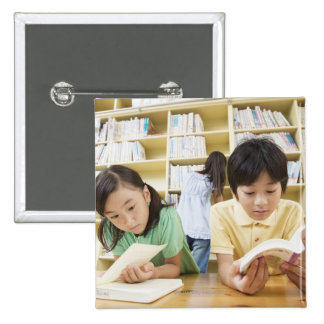 Elementary school students reading a book 15 cm square badge