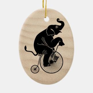 Elephant Riding a Bike Ceramic Ornament