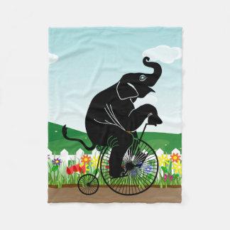 Elephant Riding a Bike Fleece Blanket