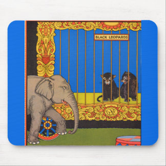 elephant strolling past the black leopards cage mouse pad