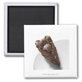 Elevated view of a piece of chocolate cake square magnet