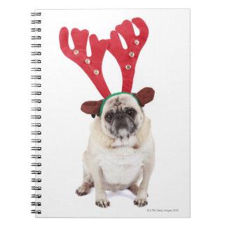 Embarrassed looking Pug wearing Reindeer Antlers Notebook