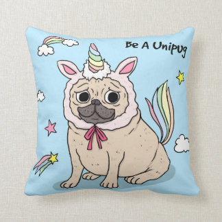 Embarrassed Pug with Unicorn Hat on Cushion