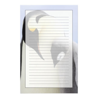 Emperor Penguin looking at chick Stationery