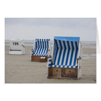 empty beach chairs on beach card