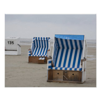 empty beach chairs on beach poster