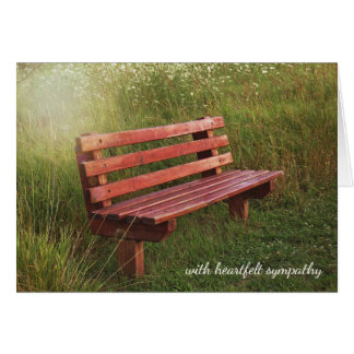 empty bench in meadow for sympathy card