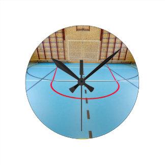 Empty european gymnasium for school sports round clock