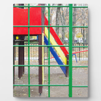 Empty playground in the park against the backdrop display plaque