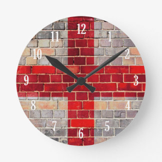 England flag on a brick wall round clock