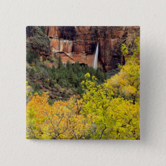 Ephemeral waterfall pours out of slot in cliff 15 cm square badge