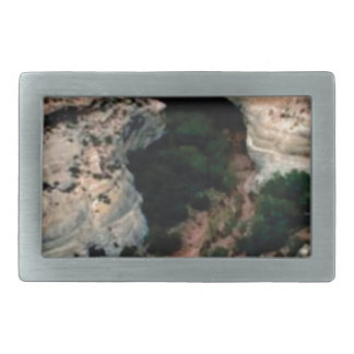Erosion pockets in desert rectangular belt buckle