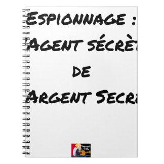 ESPIONAGE: THE AGENT SECRETES SECRET MONEY NOTEBOOK