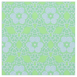 Ethnic light blue pattern on green fabric