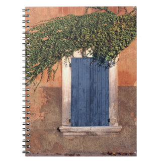Europe, France, Roussillon. Ivy covers the wall Spiral Note Books