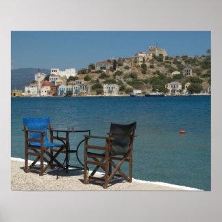 Europe, Greece, Kastellorizo: chairs on the edge Poster