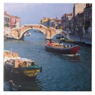 Europe, Italy, Venice. Boats bringing in Ceramic Tile