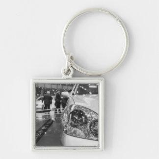 Europe, Switzerland, Geneva. Geneva Motor Show; 2 Silver-Colored Square Key Ring