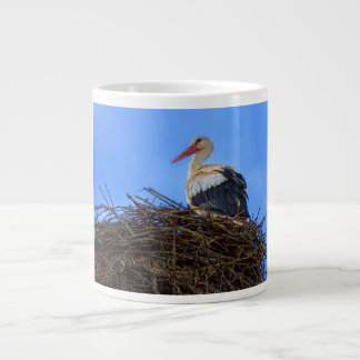 European white stork, ciconia, in the nest large coffee mug