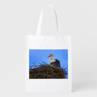 European white stork, ciconia, in the nest reusable grocery bag
