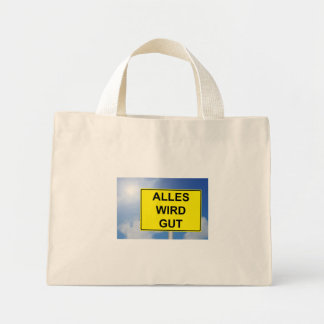 Everything becomes property sign with sky mini tote bag