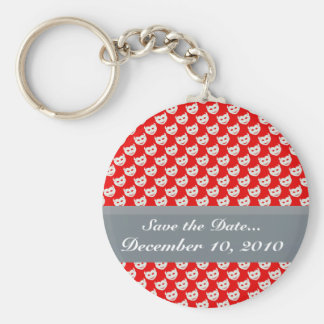 evil smiley faced white hearts on rough red surfac keychain