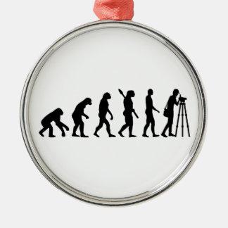 Evolution surveyor metal ornament
