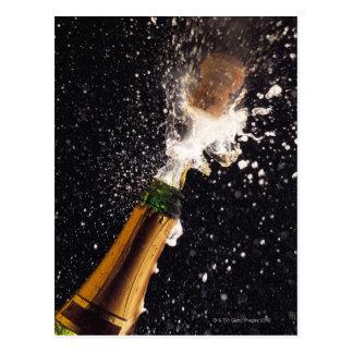 Exploding champagne bottle postcard