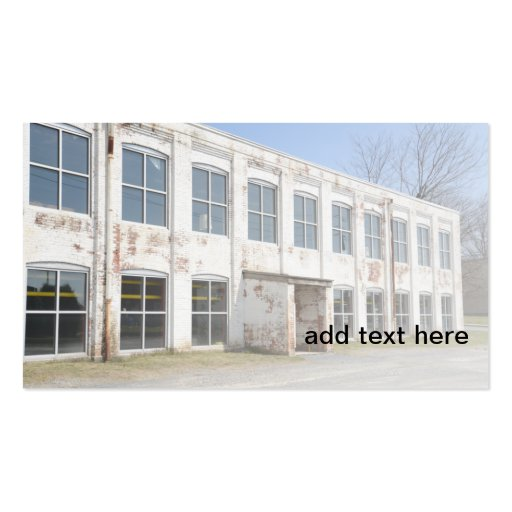 exterior of an old white brick factory building business card templates
