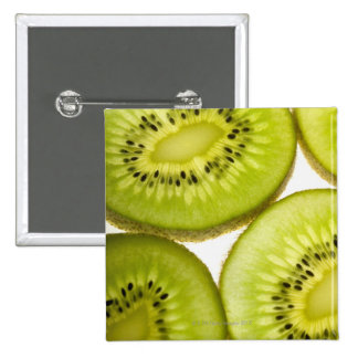 Extreme close-up of four pieces of sliced kiwi 15 cm square badge